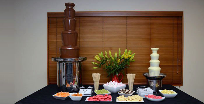 White chocolate fountain with dippers